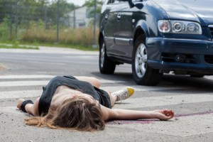 Horizontal view of car hit young woman